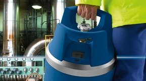 Site contractor carrying portable GENIE gas cylinder