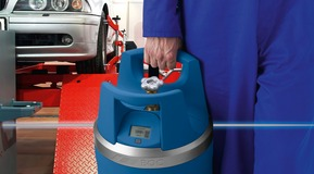 A GENIE gas cylinder being used for automative maintenance